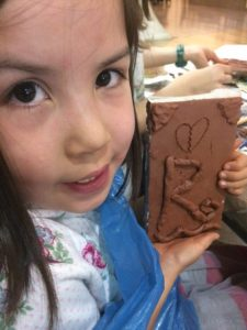 Roobs and her clay book
