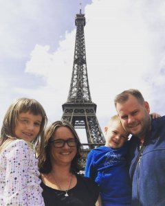Photo of the Gibbon family in front of the Eiffel tower
