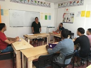 Suewan teaching at No Borders school