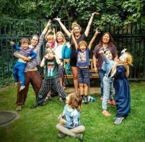 A photo of the children and adults from the Prague worldschooling hub
